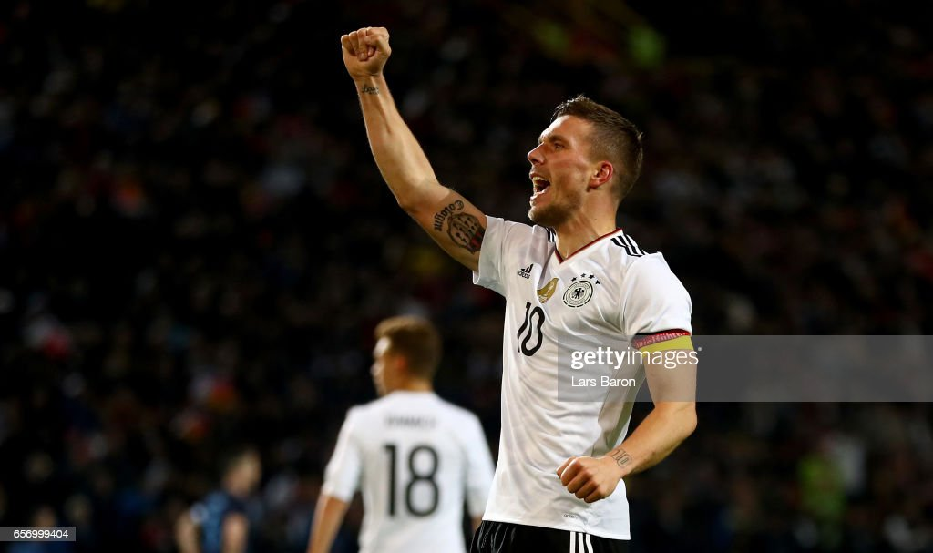 Lukas Podolski of Germany celebrates after scoring his teams first goal during the international friendly match between Germany and England at Signal Iduna Park on March 22, 2017 in Dortmund, Germany.