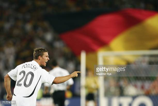 Lukas Podolski of Germany celebrates after scoring the first goal during the Euro 2008 qualifying match between Germany and the Republic of Ireland...
