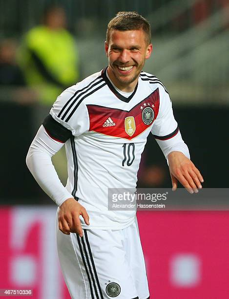 Lukas Podolski of Germany celebrates as he scores their second goal during the international friendly match between Germany and Australia at...