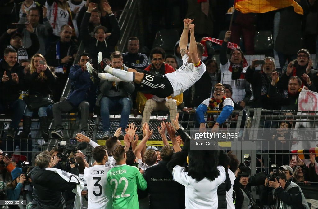 Lukas Podolski of Germany celebrates his last match with the national team with the supporters following the international friendly match between Germany and England at Signal Iduna Park on March 22, 2017 in Dortmund, Germany.
