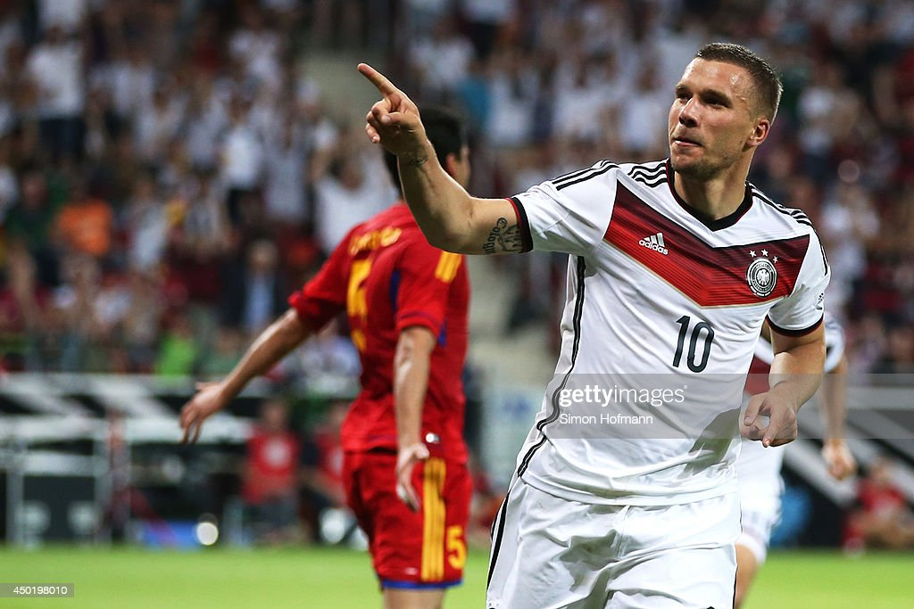 Lukas Podolski of Germany celebrates his team's second goal during the International Friendly match between Germany and Armenia at Coface Arena on June 6, 2014 in Mainz, Germany.