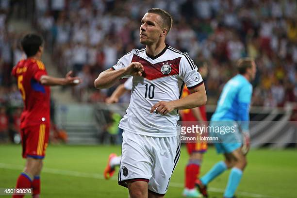Lukas Podolski of Germany celebrates his team's second goal during the International Friendly match between Germany and Armenia at Coface Arena on...