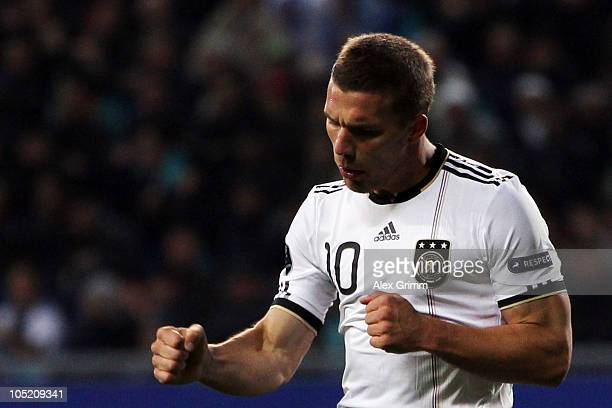 Lukas Podolski of Germany celebrates his team's third goal as Heinrich Schmidtgal of Kasakhstan reacts during the EURO 2012 group A qualifier match...