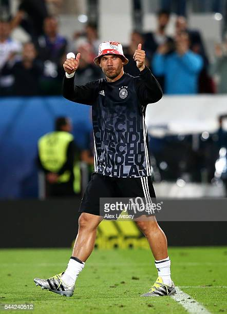 Lukas Podolski of Germany celebrates his team's win through the penalty shootout during the UEFA EURO 2016 quarter final match between Germany and...