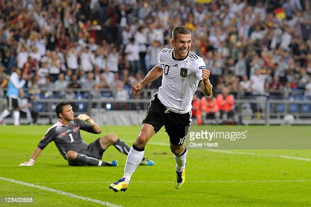 Lukas Podolski of Germany celebrates his third goal during the UEFA EURO 2012 qualifying match between Germany and Austria at Veltins-Arena on...