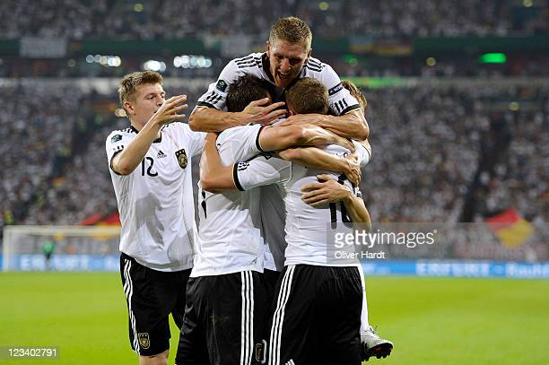 Lukas Podolski of Germany celebrates his third goal together with Miroslav Klose Bastian Schweinsteiger and Toni Kroos of Germany during the UEFA...