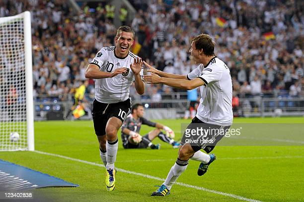 Lukas Podolski of Germany celebrates his third goal together with Holger Badstuber of Germany during the UEFA EURO 2012 qualifying match between...