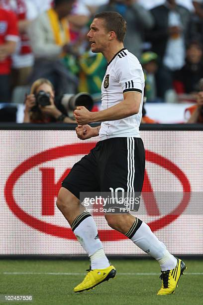 Lukas Podolski of Germany celebrates scoring Germany's second goal during the 2010 FIFA World Cup South Africa Round of Sixteen match between Germany...