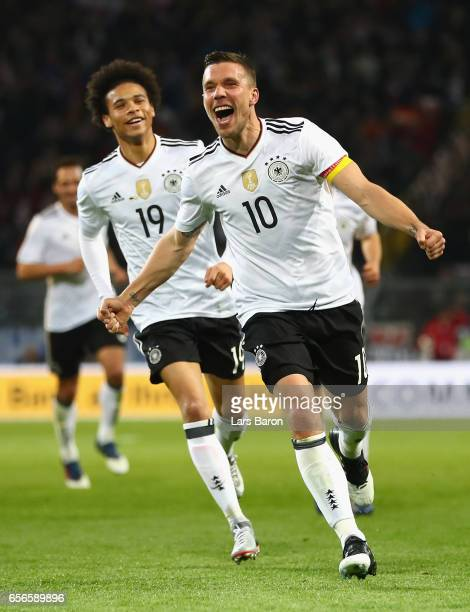 Lukas Podolski of Germany celebrates scoring his sides first goal during the international friendly match between Germany and England at Signal Iduna...