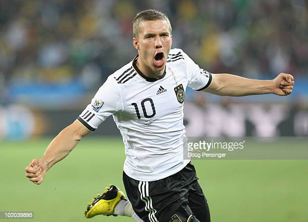Lukas Podolski of Germany celebrates scoring the first goal during the 2010 FIFA World Cup South Africa Group D match between Germany and Australia...