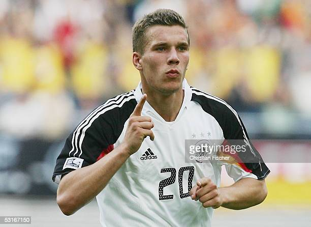 Lukas Podolski of Germany celebrates scoring the first goal during the game between germany and Mexico for the third place of the FIFA Confederations...