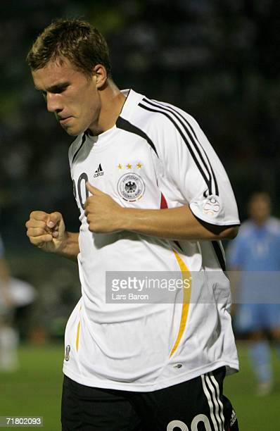 Lukas Podolski of Germany celebrates scoring the first goal during the UEFA EURO 2008 qualifier between San Marino and Germany at the Olimpico...