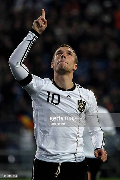 Lukas Podolski of Germany celebrates scoring the first goal during the International Friendly match between Germany and Ivory Coast at the Schalke...