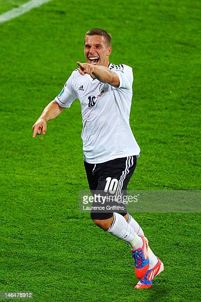 Lukas Podolski of Germany celebrates scoring their first goal during the UEFA EURO 2012 group B match between Denmark and Germany at Arena Lviv on...