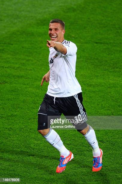 L'VIV UKRAINE JUNE 17 Lukas Podolski of Germany celebrates scoring their first goal during the UEFA EURO 2012 group B match between Denmark and...
