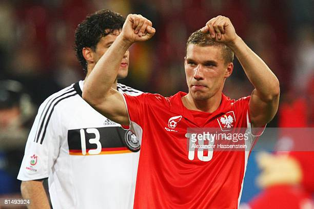 Lukas Podolski of Germany celebrates wearing a Polish shirt after the UEFA EURO 2008 Group B match between Germany and Poland at Worthersee Stadion...