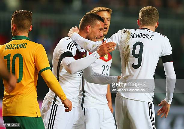 Lukas Podolski of Germany celebrates with Max Kruse and Andre Schuerrle as he scores their second goal during the international friendly match...