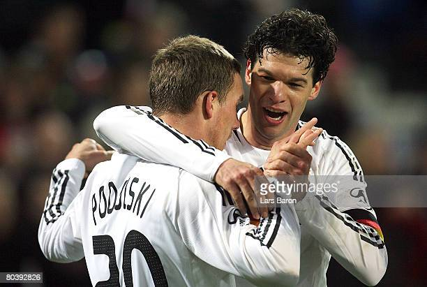 Lukas Podolski of Germany celebrates with Michael Ballack after scoring the fourth goal during the international friendly match between Switzerland...