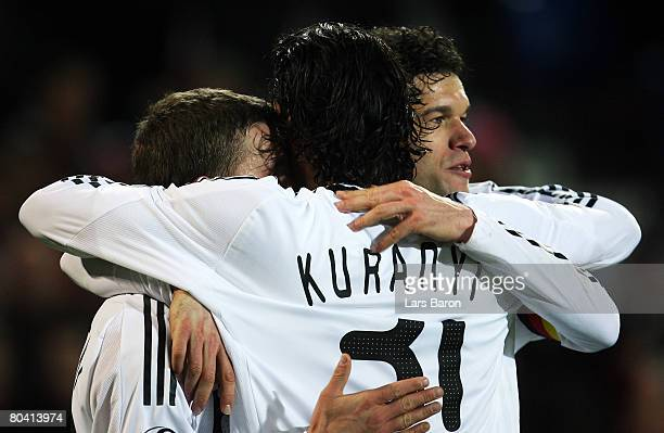 Lukas Podolski of Germany celebrates with Michael Ballack and Kevin Kuranyi after scoring the fourth goal during the international friendly match...