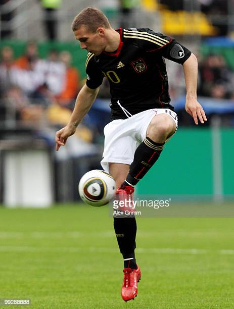Lukas Podolski of Germany controles the ball during the international friendly match between Germany and Malta at Tivoli stadium on May 13, 2010 in...