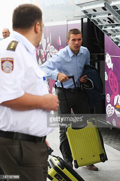Lukas Podolski of Germany departs for their UEFA EURO 2012 semifinal match against Italy at Lech Walesa Airport at Lech Walesa Airport on June 27...