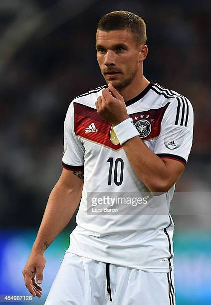Lukas Podolski of Germany gestures during the international friendly match between Germany and Argentina at EspritArena on September 3 2014 in...