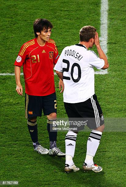 Lukas Podolski of Germany holds his eye with David Silva of Spain during the UEFA EURO 2008 Final match between Germany and Spain at Ernst Happel...