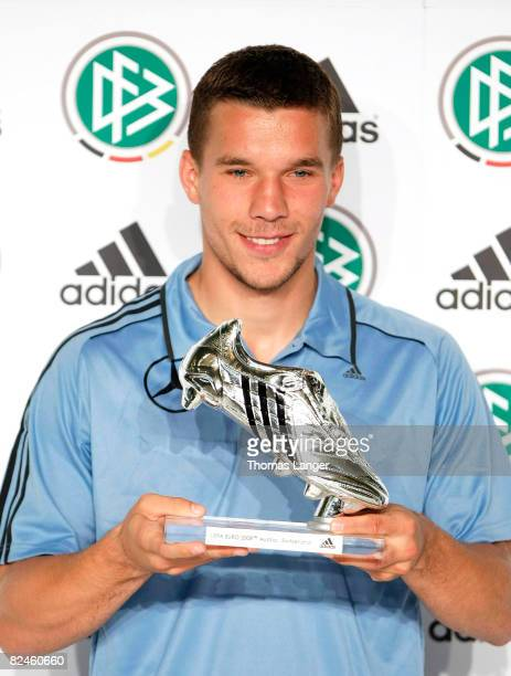 Lukas Podolski of Germany is awarded with a silver shoe the price for the second best scorer of the UEFA EURO 2008 at the Adidas Brand Center on...