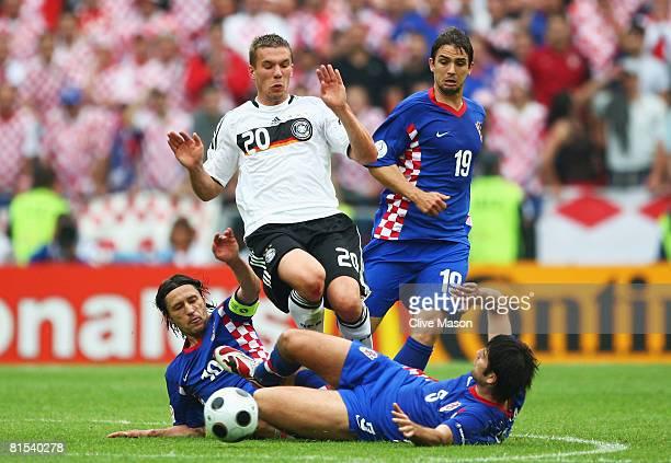 Lukas Podolski of Germany is challenged by Niko Kovac Niko Kranjcar and Vedran Corluka of Croatia during the UEFA EURO 2008 Group B match between...