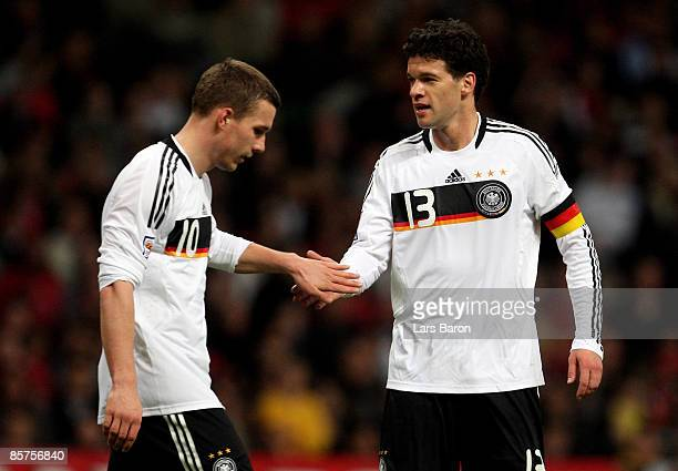 Lukas Podolski of Germany is seen with Michael Ballack during the FIFA 2010 World Cup Group 4 Qualifier match between Wales and Germany at the...