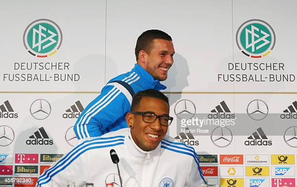 Lukas Podolski of Germany laughs while leaving the press conference ahead of their EURO 2016 Group D qualifying match against Gibraltar on November...