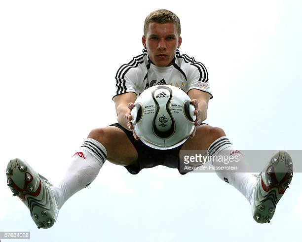 Lukas Podolski of Germany poses with the adidas matchball specifically designed for the Opening Match of the FIFA World Cup 2006 Germany Germany vs...