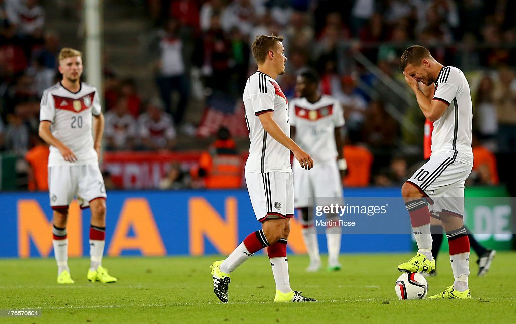 Lukas Podolski (R) of Germany reacts during the International Friendly match between Germany and USA at RheinEnergieStadion on June 10, 2015 in Cologne, Germany.