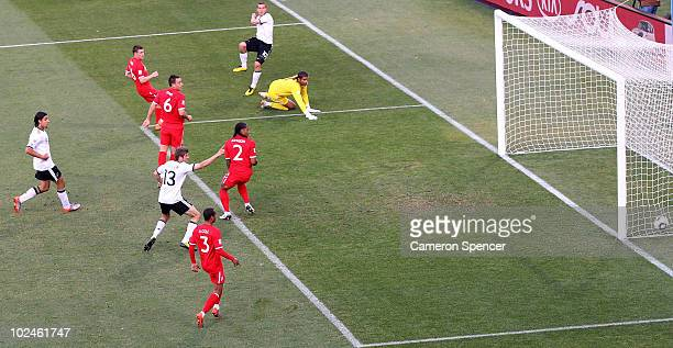 Lukas Podolski of Germany scores his side's second goal past David James of England during the 2010 FIFA World Cup South Africa Round of Sixteen...