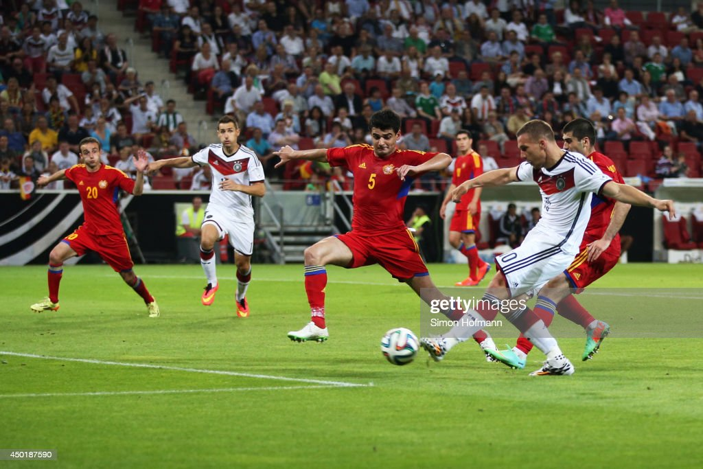 Lukas Podolski of Germany scores his team's second goal during the International Friendly match between Germany and Armenia at Coface Arena on June 6, 2014 in Mainz, Germany.
