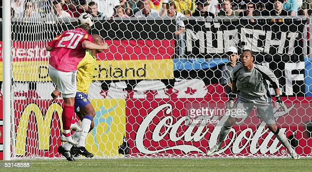 Lukas Podolski of Germany scores the first goal during the Semi Final match between Germany and Brazil in the FIFA Confederations Cup 2005 at the...