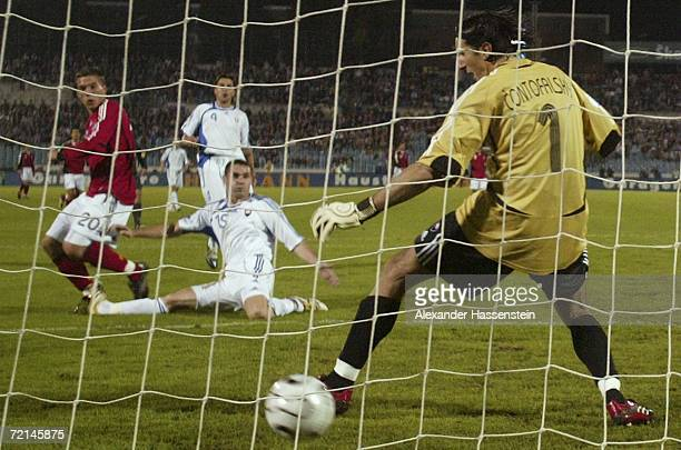 Lukas Podolski of Germany scores the first goal during the UEFA Euro2008 qualifier between Slovakia and Germany at the Tehelne Pole stadium on...