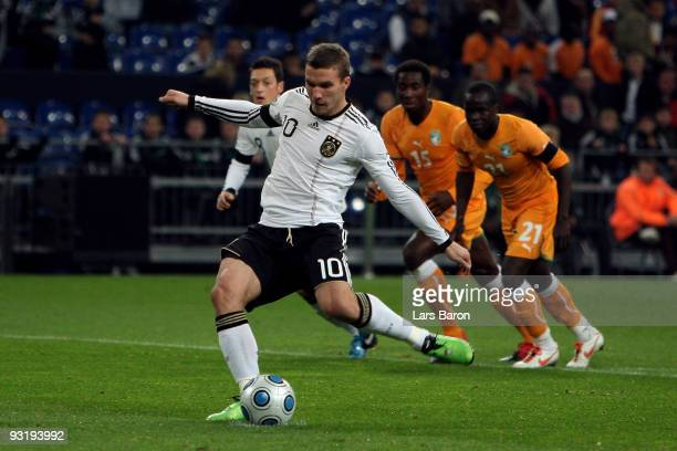 Lukas Podolski of Germany scores the first goal from the penalty spot during the International Friendly match between Germany and Ivory Coast at the...
