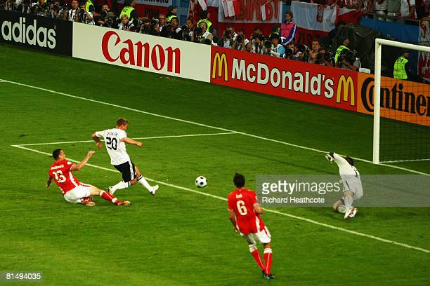 Lukas Podolski of Germany scores the opening goal during the UEFA EURO 2008 Group B match between Germany and Poland at Worthersee Stadion on June 8...