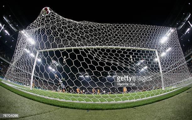 Lukas Podolski of Germany scores the third goal against Danut Coman of Romania during a friendly football match between Germany and Romania at the...