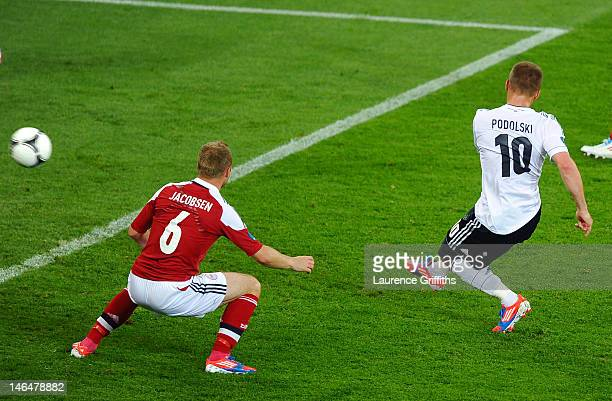 L'VIV UKRAINE JUNE 17 Lukas Podolski of Germany scores their first goal during the UEFA EURO 2012 group B match between Denmark and Germany at Arena...