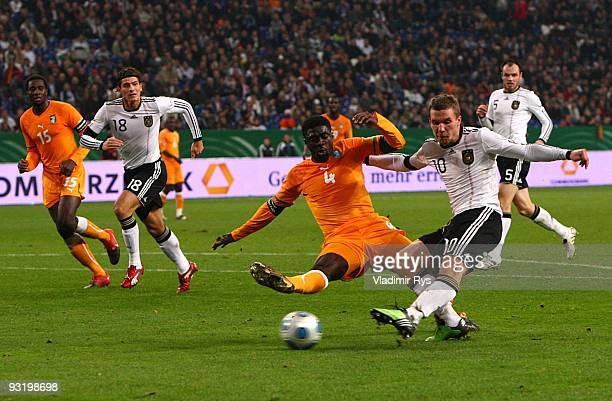Lukas Podolski of Germany shoots to score his second goal during the international friendly match between Germany and Ivory Coast at the Schalke...
