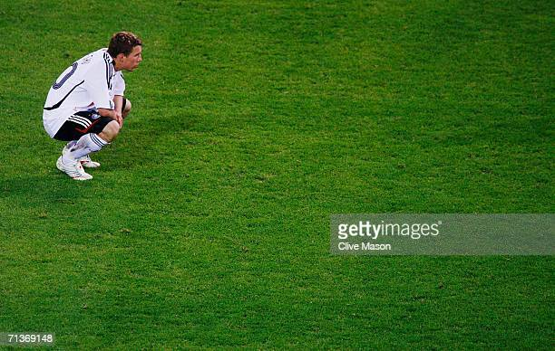 Lukas Podolski of Germany shows his dejection following his team's defeat at the end of the FIFA World Cup Germany 2006 Semifinal match between...