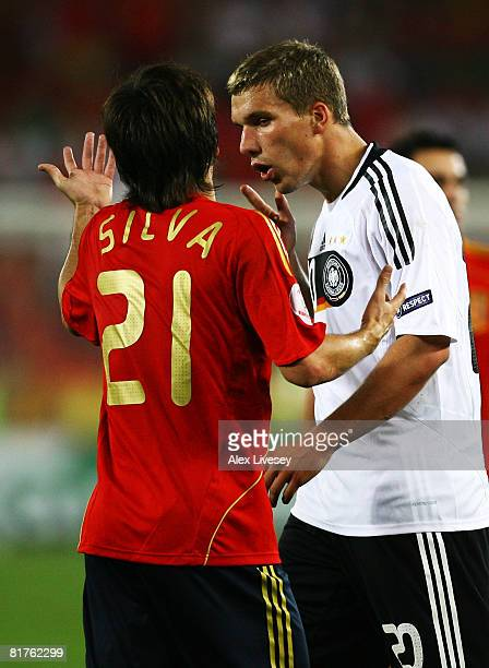 Lukas Podolski of Germany talks to David Silva of Spain during the UEFA EURO 2008 Final match between Germany and Spain at Ernst Happel Stadion on...