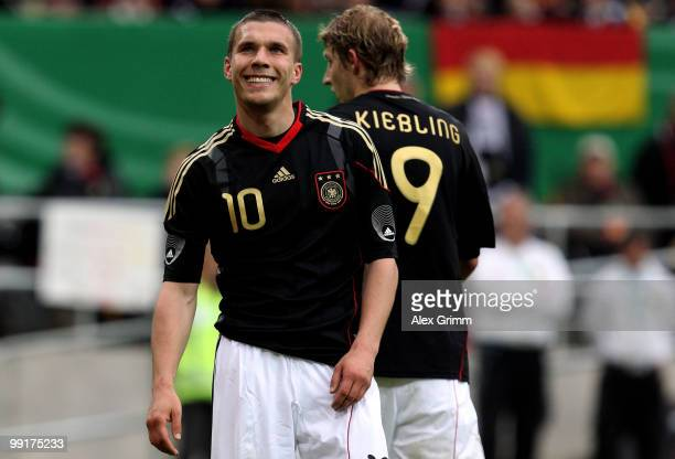 Lukas Podolski of Germany walks past with team mate Stefan Kiessling during the international friendly match between Germany and Malta at Tivoli...