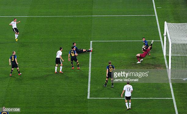 Lukas Podolski of Germany watches as his shot goes into the net past Mark Schwarzer of Australia during the 2010 FIFA World Cup South Africa Group D...