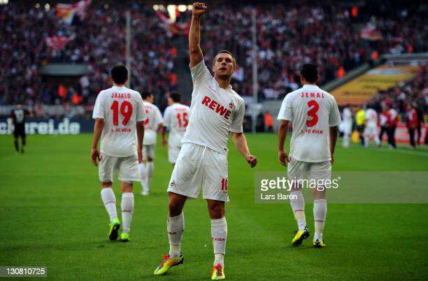 Lukas Podolski of Koeln celebrates after scoring his teams first goal during the Bundesliga match between 1. FC Koeln and FC Augsburg at...