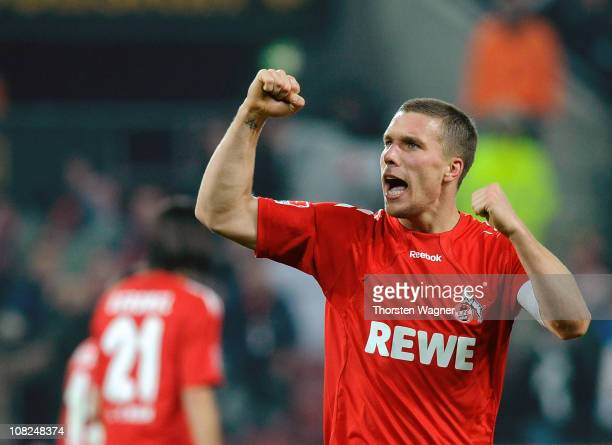 Lukas Podolski of Koeln celebrates after scoring his team's third goal during the Bundesliga match between 1FC Koeln and SV Werder Bremen at...
