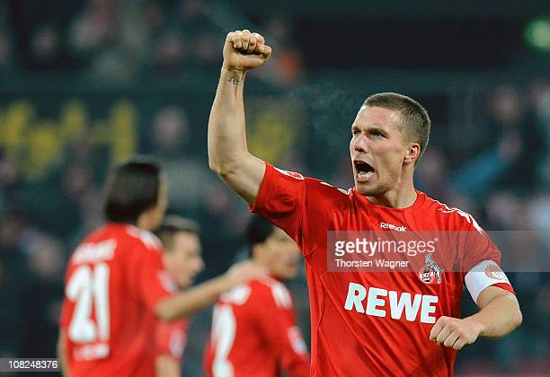 Lukas Podolski of Koeln celebrates after scoring his teams third goal during the Bundesliga match between 1FC Koeln and SV Werder Bremen at...
