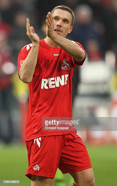 Lukas Podolski of Koeln celebrates after the Bundesliga match between 1 FC Koeln and FSV Mainz at RheinEnergieStadion on February 13 2011 in Cologne...